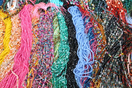 thousands: thousands of colorful necklaces  on sale in the market