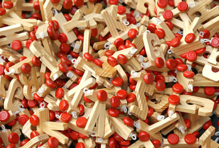 u k: many letters in wood with Red wheels to compose words and name of children