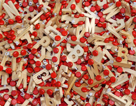 d i y: many letters in wood with Red wheels to compose words and name of children