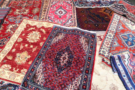 prayer rug: many colored carpets decorated in an islamic mosque Stock Photo
