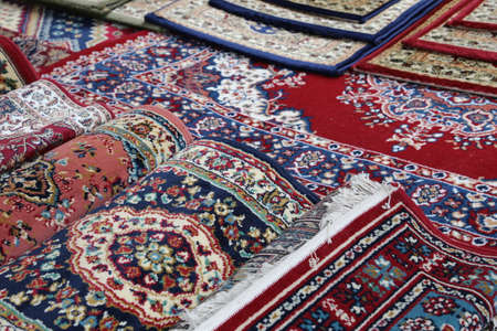prayer rug: many colourful Oriental rugs for sale in the shop of rugs