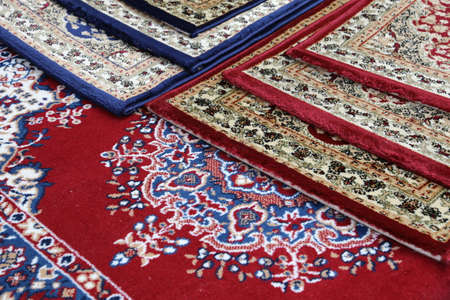 prayer rug: many colored carpets decorated in a mosque