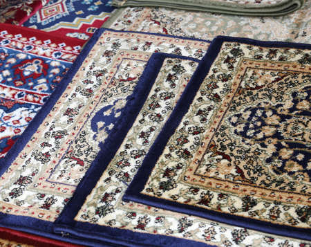 prayer rug: oriental carpets for sale in the shop of rugs Stock Photo
