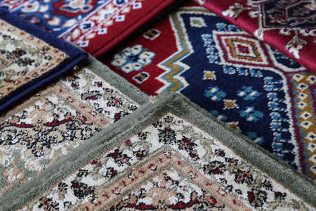prayer rug: colored carpets decorated in an islamic mosque