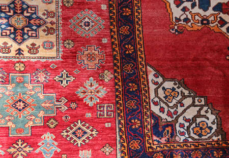 two colored carpets decorated in an islamic house