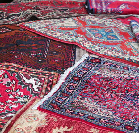 prayer rug: many Asian rugs for sale in the shop of fabrics and textiles