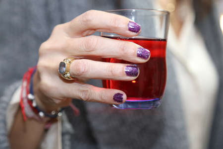 elegant womans hand that holds the glass for the toast Stock Photo
