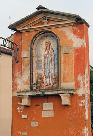 votive: ancient votive capitals with the image of the madonna in Italy