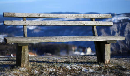 wooden bench: ancient wooden bench isolated in the high mountain in winter Stock Photo