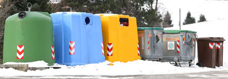 waste paper: many trash bins for waste paper and used glass bottles in the mountains Stock Photo
