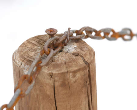 constrain: Rust chain with the wooden pole and white background