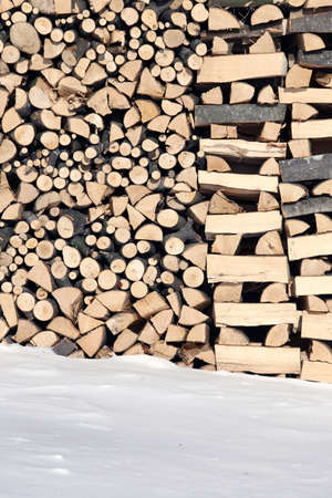woodshed: wide Woodshed with pieces of wood piled for winter