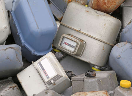 disused: old obsolete disused gas counters in a landfill of waste Stock Photo
