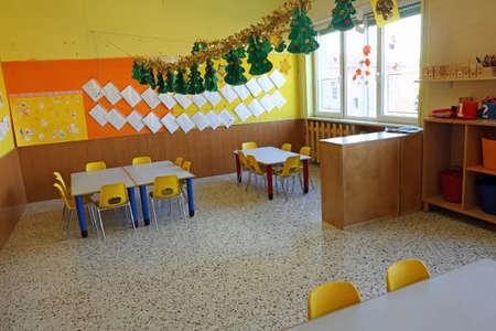 kindergarten: kindergarten classroom with yellow chairs and table