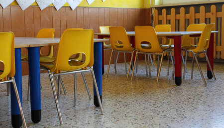 educational institution: kindergarten classroom with yellow chairs and table