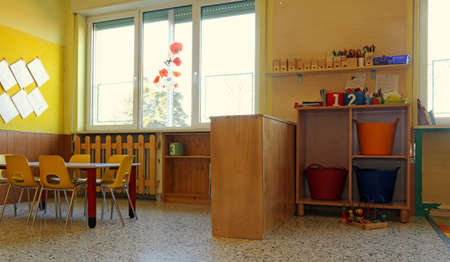nursery school: kindergarten classroom with yellow chairs and table