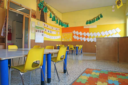 Preschool classroom with yellow chairs and table photo