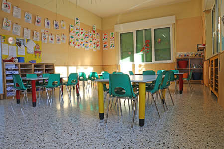 kindergarten class with the green chairs and little tables 写真素材