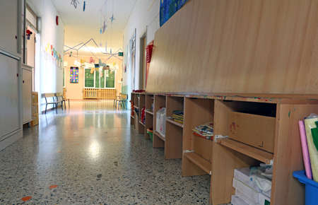 pedagogy: wide corridor of a nursery with the decorations hung on walls Stock Photo