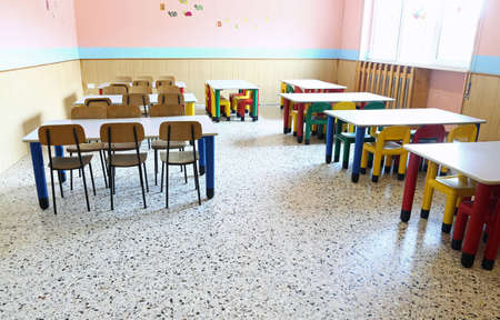 refectory of kindergarten with small tables and chairs for children Stock Photo