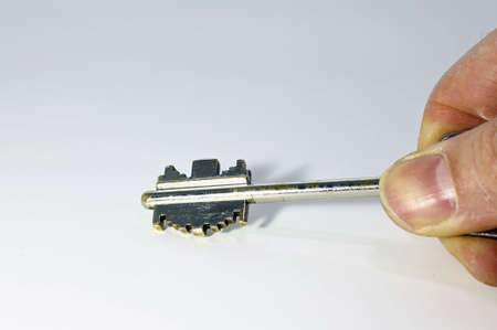 duplicate: adult hand with the key of safe deposit box Stock Photo