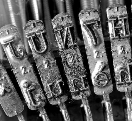 antiquarian: detail of levers of a very old typewriter