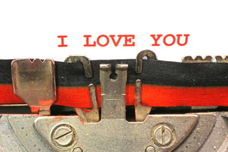 written by typewriter I LOVE YOU with red ink photo
