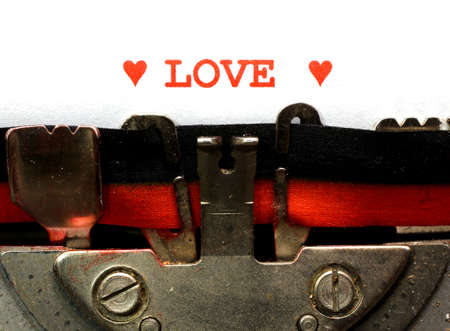 written typewriter LOVE and Hearts red ink photo