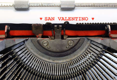 saint valentine   s day: italian written typewriter Saint Valentine and two red hearts Stock Photo