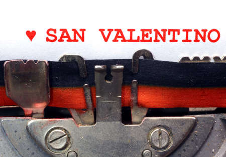 italian written typewriter Saint Valentine with red heart photo