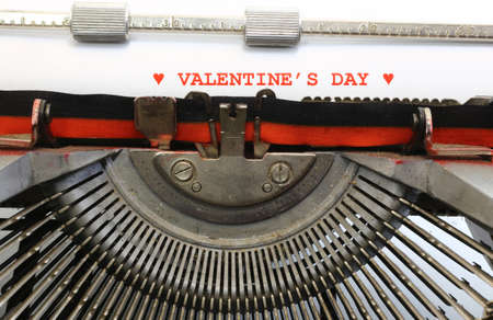 written with the typewriter Valentines Day in red ink photo