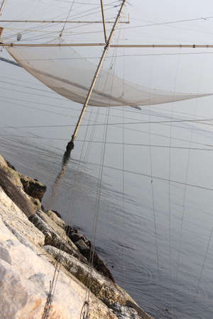 fishing nets: fishing nets over the Stilt houses of wood
