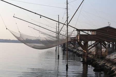 stilt house: fishing nets over the Stilt houses of wood