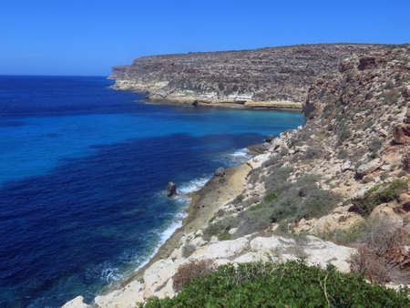 agrigento: Landscape of the island of Lampedusa in Italy with high cliffs and clean blue sea
