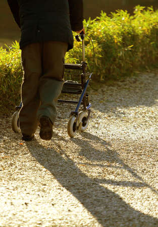 infirm: disabled elderly with medical Walker for walking in the Park