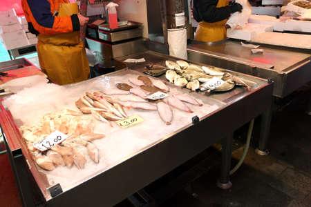 daurade: fishmonger sells the fresh fish at the fish market in Italy Stock Photo