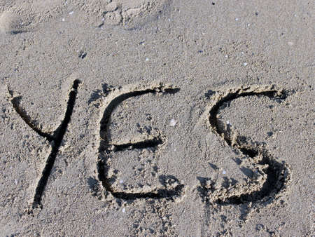 alright: written YES engraved on the sand of the Beach
