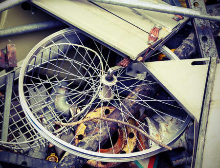 landfills: part of  bicycle in the container for the collection