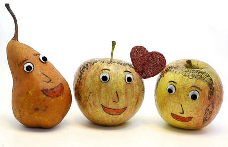 analogy: apples with the heart and a PEAR with eyes Stock Photo