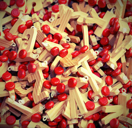 s c u b a: many letters in wood with Red wheels to compose words and name