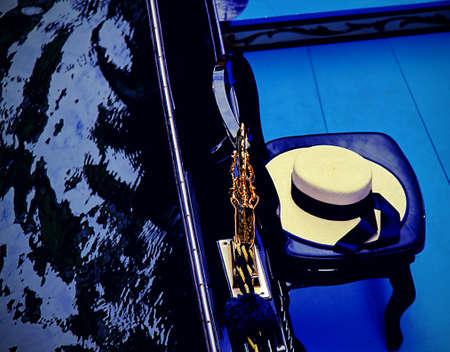 gondoliers: Venetian gondoliers hat on a gondola in Venice in th water