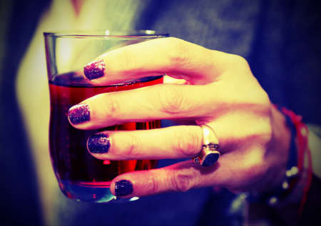 elegant womans hand that holds the glass during the party Stock Photo