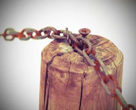 constrain: chain with the wooden pole and white background