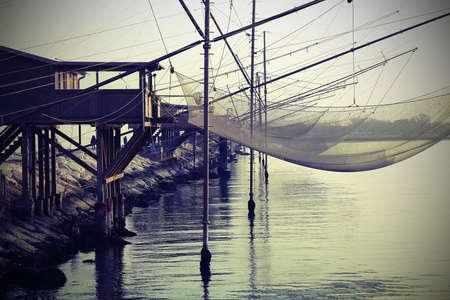 stilt house: fishing nets over the Stilt houses Stock Photo