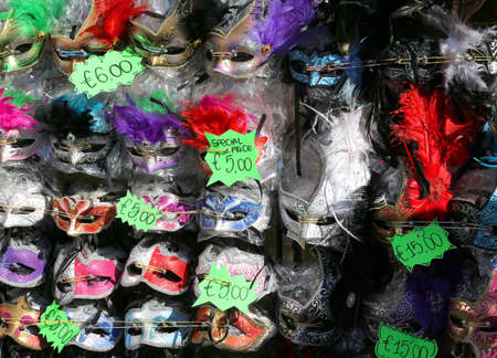 carnevale: many Venetian masks for sale in a stand in St Mark square in Venice Italy