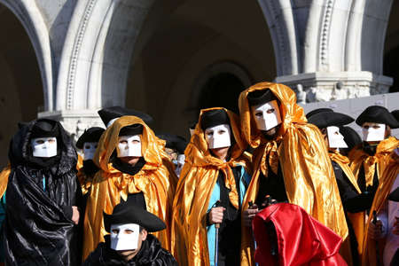 People with Golden costumes for the Carnival in Venice Italy photo