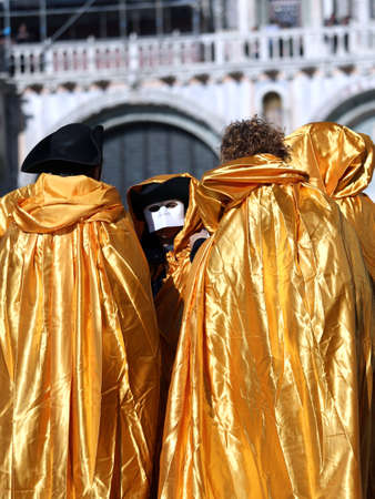 People with Golden costumes for the Carnival in Venice Italy Imagens - 36263765