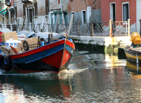 great boat for transporting goods into the navigable Canal in Venice