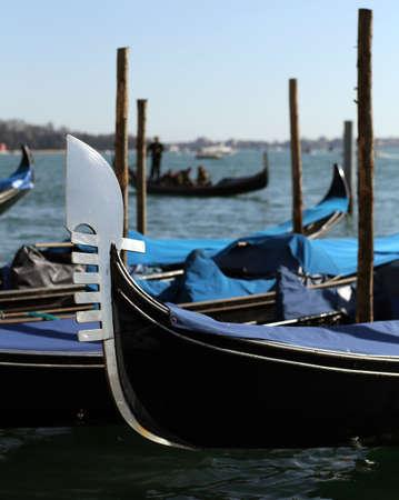 prongs: gondolas on the water in venice italy near saint mark square