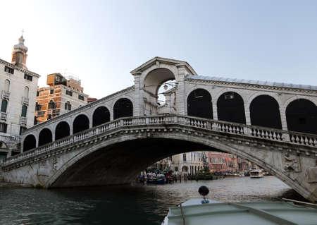 rialto bridge: Rialto Bridge and the Grand Canal in Venice Italy from vaporetto boat Stock Photo